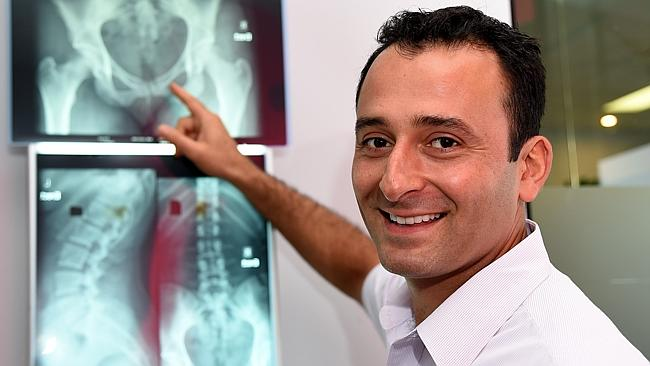 Chiropractor Hooman Zahedi says prolonged periods of sitting affect both internal organs and spinal health. Picture: News Corp
